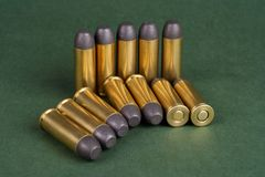 The .45 Revolver cartridges Wild West period. On green background Royalty Free Stock Image