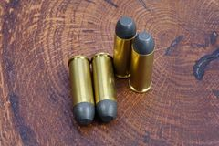 The .45 Revolver cartridges Wild West period. On wooden background Royalty Free Stock Photo