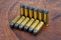 The .45 Revolver cartridges Wild West period. On wooden background Royalty Free Stock Images