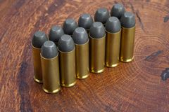 The .45 Revolver cartridges Wild West period. On wooden background Royalty Free Stock Image
