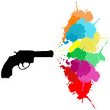 Revolver with colored paint splashes Stock Image