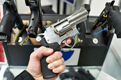 Revolver Dan Wesson in hand of buyer on arms store Royalty Free Stock Photo