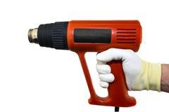 Revolver de chaleur en main dans le glowe sur le fond blanc d'isolement photo stock