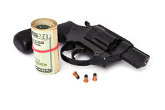 Revolver and dollars Stock Photos