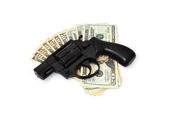 Revolver and dollars Royalty Free Stock Photos
