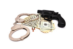 Revolver and dollars Royalty Free Stock Images