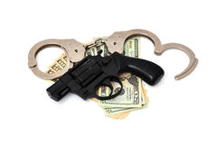 Revolver,  dollars and the handcuffs Royalty Free Stock Photo