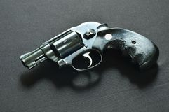 Revolver gun on black fabric background Royalty Free Stock Photography