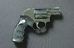 Revolver gun on black fabric background Stock Images
