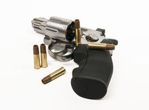 Revolver gun and bullet. Isolated on white background Stock Images