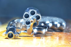 Revolver gun without bullet on wooden table Stock Photos