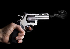 Revolver gun in hand Royalty Free Stock Photo