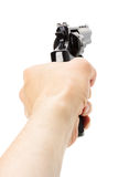 Revolver Gun in hand on the white background Stock Photo