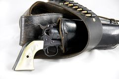 Revolver Gun in Holster. An old western six gun revolver isolated against  a white background in the  horizontal format with copy space Royalty Free Stock Images