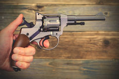 Revolver gun in a human hand Royalty Free Stock Photography