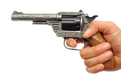 Revolver in hand Stock Photos