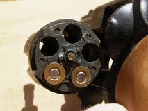 Revolver hand gun with bullets. Detail photo of the open revolver gun with bullets Stock Photo