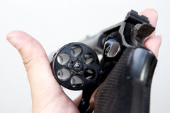 Revolver. The revolver hand gun holding on hand in white background royalty free stock photos
