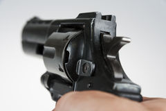 Revolver. Hand holding a large black revolver royalty free stock image