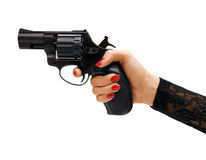 Revolver in hand. Studio photography of woman's hand stock images