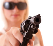 Revolver in hands of sexy woman isolated Royalty Free Stock Photos