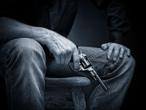 Revolver in his hand. Male with a revolver in his hand Royalty Free Stock Images