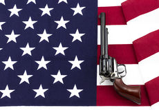 Revolver laying on an American flag Royalty Free Stock Photo