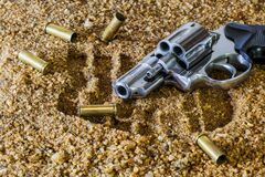 Revolver lying on sands Stock Photography