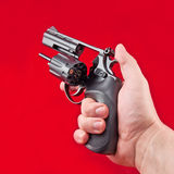 Revolver in the man's hand. Russian roulette Royalty Free Stock Images