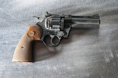 Revolver on metal background Royalty Free Stock Image