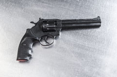 Revolver on metal background Royalty Free Stock Photo