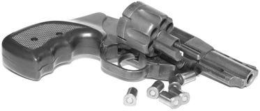 Revolver mit der Kugelnahaufnahme lokalisiert auf weißem Hintergrund/Schwarzweiss-Foto in einem Retrostil Stockfotos