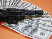Revolver and money. Revolver, money as a fan Stock Images