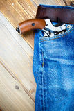 Revolver nagant in the pocket of old blue jeans Royalty Free Stock Photo