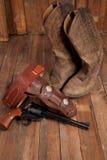 Revolver och cowboy Boots Fotografering för Bildbyråer