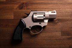 Revolver. Pistol on a wood background Royalty Free Stock Photo