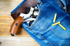 Revolver in the pocket Stock Images