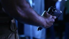 Revolver at police hand closeup stock video