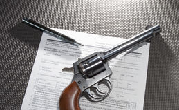 Revolver purchase paperwork Stock Images