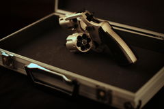 Revolver. Reveolver gun in a metal case Stock Images