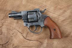 Revolver on the table. Revolver on the wooden table Royalty Free Stock Photo