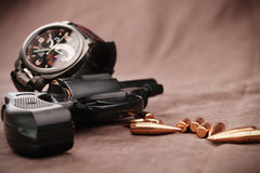 Revolver with watch and bullets Royalty Free Stock Photography