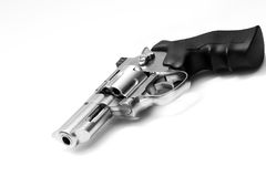 Revolver on white. Beautiful revolver lies on a white background Royalty Free Stock Image