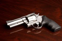 Revolver Wooden Surface Stock Photography