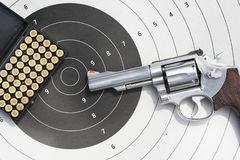Gun with 9mm bullets on the target. Revolvers gun with 9mm bullets on the target Stock Images