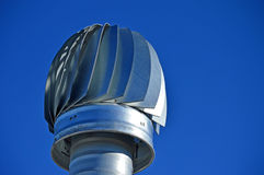 A Revolving Air Vent - Very Blue Sky Background Royalty Free Stock Photography