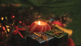 Revolving christmas candle with presents and ornaments stock video footage