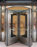 Revolving Door. Metal and glass revolving door Royalty Free Stock Images