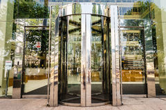 Revolving door. On a modern glass building Stock Photo