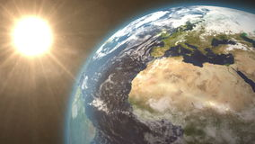 Revolving earth and bright sun stock video footage